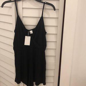 Romper black size 4
